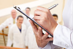 Team of Doctors Being Assessed Royalty Free Stock Photos