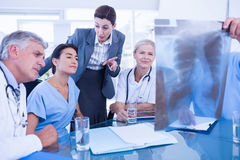 Team of doctors and businesswoman examining xray Stock Photo