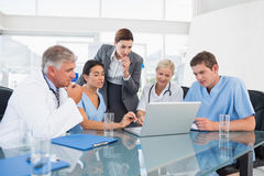 Team of doctors and businesswoman having a meeting Royalty Free Stock Photo