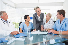 Team of doctors and businesswoman having a meeting Royalty Free Stock Images