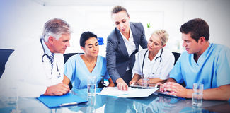 Team of doctors and businesswoman having a meeting vector illustration