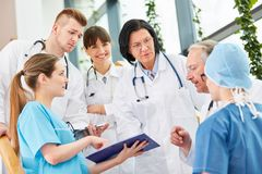 Team of doctors with chief executive physicians. Planning in teamwork stock image