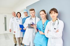 Team of doctors with competence. Team of doctors as group with competence in clinic or hospital royalty free stock photos