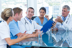 Team of doctors discussing about file Stock Photos