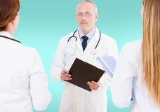 Team of doctors discussing something isolated on blue background,mock up stock photography