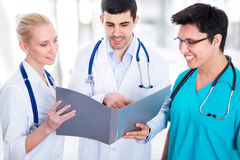 Team of doctors. Doctor giving his colleagues a piece of advice concerning the diagnosis Royalty Free Stock Photo