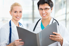 Team of doctors. Doctor giving his younger colleague a piece of advice concerning the diagnosis Stock Photography