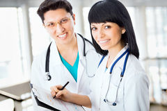 Team of doctors. Doctor giving his younger colleague a piece of advice concerning the diagnosis Stock Photo