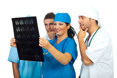 Team of doctors examine a magnetic resonance Royalty Free Stock Images