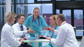 Team of doctors having a meeting in conference room stock video footage