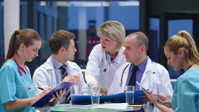Team of doctors having a meeting in conference room stock video