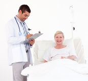 Team of doctors helping a patient Stock Photos