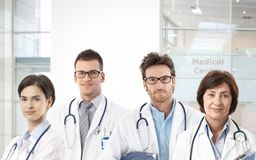 Team of doctors in hospital lobby Stock Photo