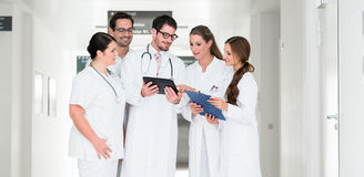 Team of doctors in hospital working on documents Royalty Free Stock Photo
