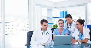 Team of doctors looking at laptop Royalty Free Stock Image