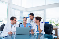 Team of doctors looking at laptop Stock Image