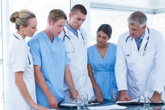 Team of doctors looking at their diaries Stock Photography