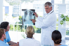 Team of doctors looking at xray Stock Photo
