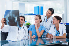 Team of doctors looking at xray Royalty Free Stock Images