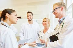 Team of doctors in meeting. Cooperating and working together royalty free stock photography