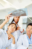 Team of doctors with x-ray image Stock Photo