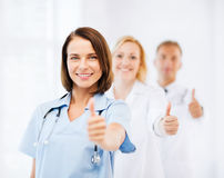 Team of doctors showing thumbs up Royalty Free Stock Photos