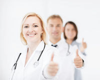 Team of doctors showing thumbs up Stock Photography