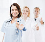 Team of doctors showing thumbs up Royalty Free Stock Images