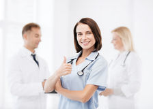 Team of doctors showing thumbs up Stock Images