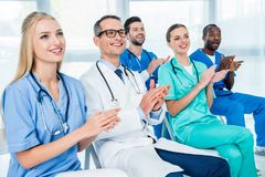 Doctors listening to lecture Royalty Free Stock Image