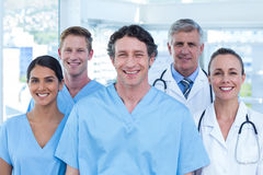 Team of doctors smiling at camera Royalty Free Stock Photography