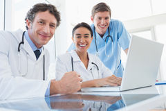 Team of doctors smiling at camera Stock Images
