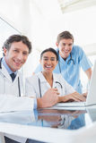 Team of doctors smiling at camera Stock Photography