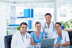Team of doctors smiling at camera Royalty Free Stock Image
