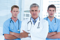 Team of doctors standing arms crossed Royalty Free Stock Image