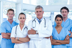 Team of doctors standing arms crossed Royalty Free Stock Images