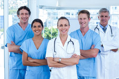 Team of doctors standing arms crossed and smiling at camera Stock Photography