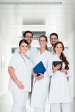 Team of doctors standing in hospital corridor Stock Photography