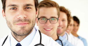 Team of doctors standing in row smiling at camera stock video footage