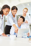 Team of doctors in training. Interracial team of doctors learning together in training Stock Photography