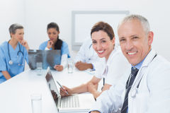 Team of doctors working on laptop and analyzing xray Royalty Free Stock Photography