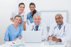 Team of doctors working on laptop Royalty Free Stock Photos