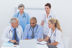 Team of doctors working on laptop Royalty Free Stock Image