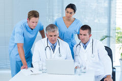 Team of doctors working on laptop Royalty Free Stock Photography