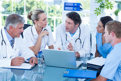 Team of doctors working on laptop Stock Photos