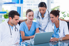 Team of doctors working on laptop Stock Image
