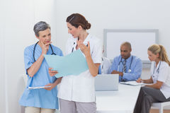 Team of doctors working on their files Royalty Free Stock Photos