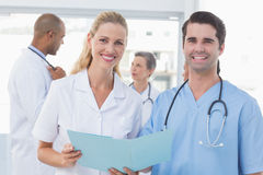 Team of doctors working on their files Stock Photos