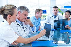 Team of doctors working on their files Royalty Free Stock Images