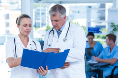 Team of doctors working on their files Stock Photo